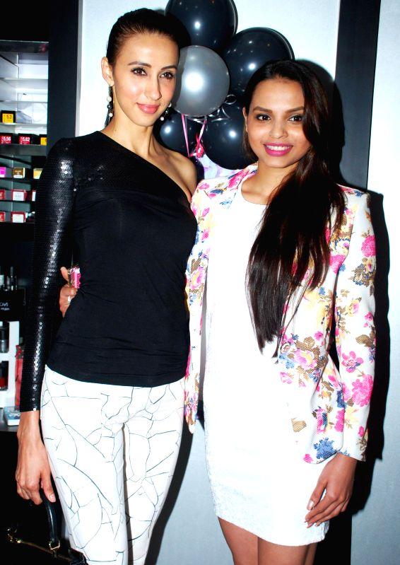 Super Model Alesia Raut and Femina Miss India - Gail Nicole Da Silva during launch of Glow Studio Salon and Spa beauty salon in Thane, on March, 01, 2015. - Alesia Raut