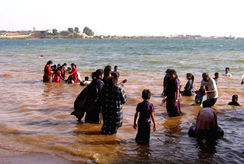Tourists take bath in Keenjhar Lake in southern Pakistan's Thatta on May 12, 2014. Keenjhar Lake is the second largest fresh water lake in Pakistan. It is an ...