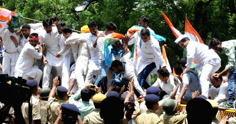 The activists of Youth congress, NSUI and Mahila Congress stage a demonstration over price rise of essential commodities, in New Delhi, on July 20, 2016.