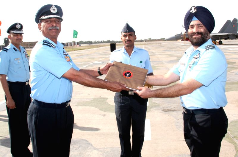 The Air Officer Commanding-in-Chief Western Air Command, Air Marshal C Hari Kumar hands over the documents of the first Sukhoi Su-30MKI aircraft to Wg. Cdr. HS Luthra, Commanding Officer, ...