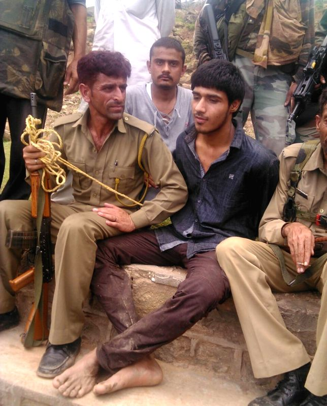 The alleged militant who was involved in an ambush on a BSF convoy on the Jammu-Srinagar highway after being captured; in Udhampur district of Jammu and Kashmir on Aug 5, 2015.