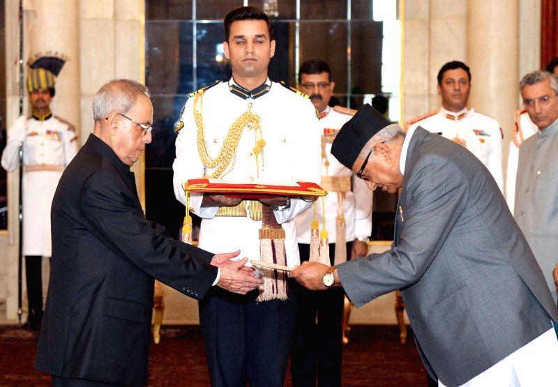 The Ambassador-designate of Nepal Deep Kumar Upadhyay presents his credentials to President Pranab Mukherjee, at Rashtrapati Bhavan, in New Delhi on April 30, 2015. - Deep Kumar Upadhyay and Pranab Mukherjee