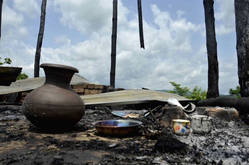 The belonging of the residents of a house that was set on fire after people of  two communities clashed in North Tripura lay unattended on May 16, 2016.
