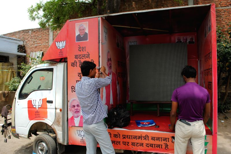 The BJP is all set to unleash 'Modi raths' in Amethi. A dozen of these mini-vans, mounted with large LCD screens, will spread out to villages of the constituency and show speeches and other campaign . - Narendra Modi, Smriti Irani and Rahul Gandhi