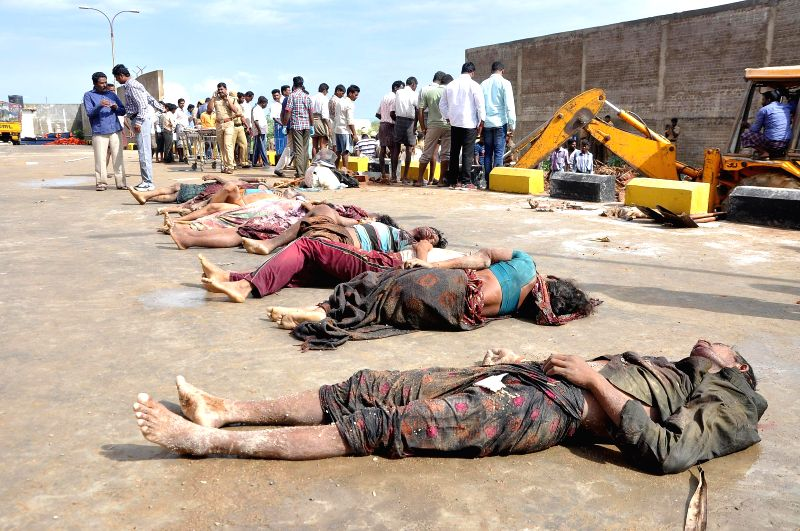 The bodies of the construction workers who were killed after a wall which was being built for a private warehouse collapsed on the huts abutting it in Tamil Nadu's Tiruvallur district on July 6, ...