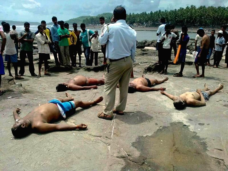 The bodies of the persons who drowned at Murud beach in Raigad district of Maharashtra on July 6, 2014.