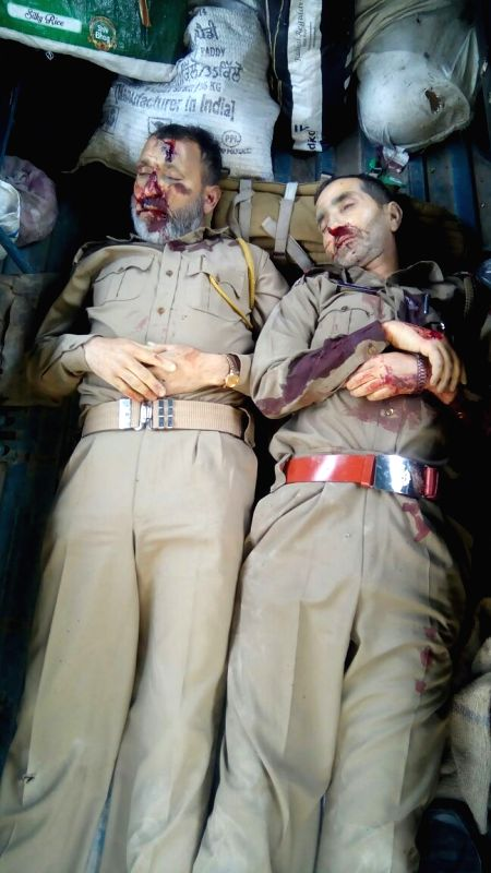 The bodies of two policemen, who were killed by separatist guerrillas in a hit and run attack in Srinagar on May 23, 2016.
