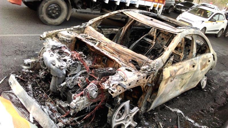 The car that caught fire on Delhi-Noida-Delhi Flyway on May 2, 2017.
