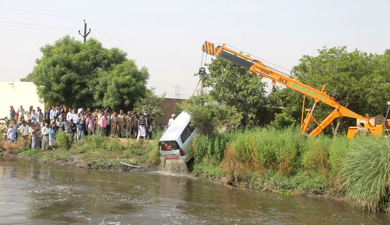 The car that fell into a canal along the Mathura-Jajampatti road being fished out on June 11, 2017. Ten people, including nine members of a family, were killed in the accident.