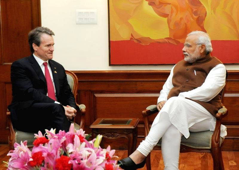 The chairman and CEO of Bank of America, Brian Moynihan calls on Prime Minister Narendra Modi, in New Delhi on Dec 3, 2014. - Narendra Modi