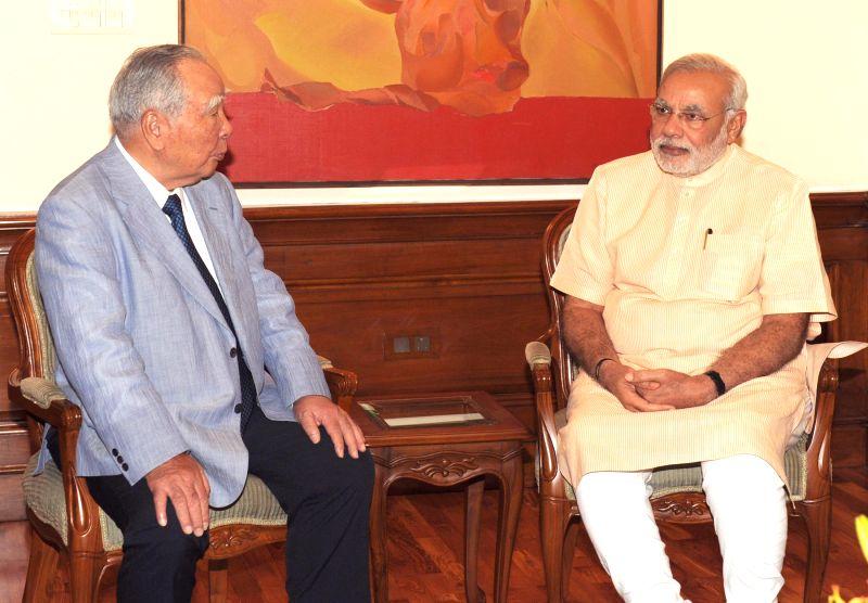 The Chairman and CEO of Suzuki Motor Corporation, Osamu Suzuki calls on Prime Minister Narendra Modi, in New Delhi on July 31, 2014. - Narendra Modi