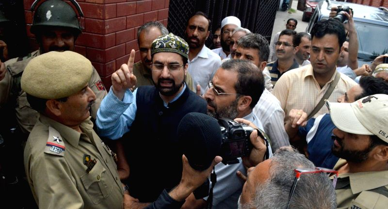 The chairman of moderate faction of Hurriyat Conference, Mirwaiz Umar Farooq being taken away by police from his Srinagar residence on July 25, 2016.