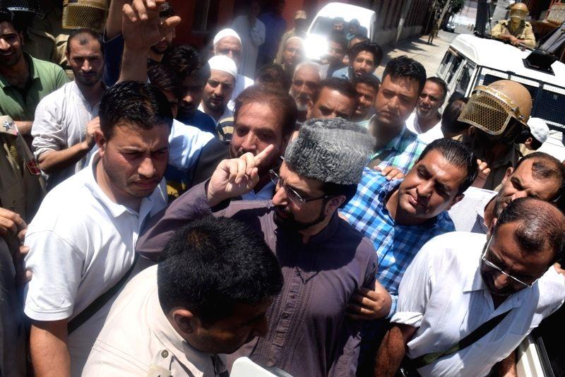 The chairman of moderate faction of Hurriyat Conference, Mirwaiz Umar Farooq being taken away by police in Srinagar on July 29, 2016.