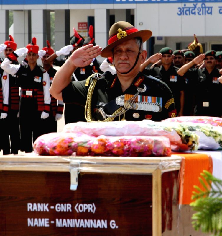 The Chief of Army Staff, General Bipin Rawat pays homage at the mortal remains of NK. Dipak Kumar Maity, in New Delhi on June 4, 2017. - Dipak Kumar Maity