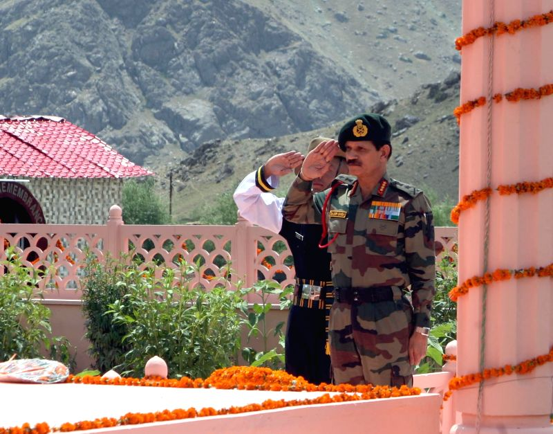 The Chief of Army Staff General Dalbir Singh pays homage to the martyrs of OP VIJAY at the historic Kargil War Memorial, at Drass, Jammu and Kashmir on July 25, 2016.