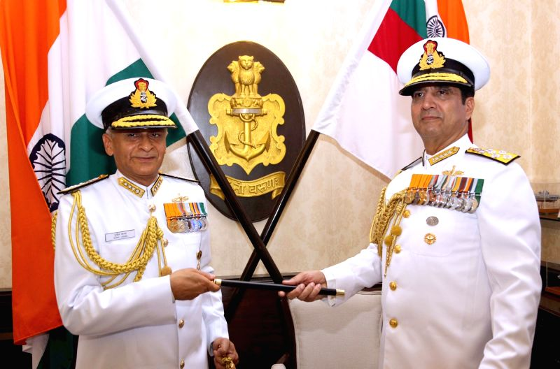 The Chief of Naval Staff, Admiral Sunil Lanba being handed over the baton by the outgoing Chief of Naval Staff, Admiral R.K. Dhowan, in New Delhi on May 31, 2016.