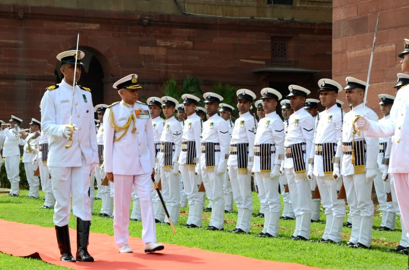 The Chief of Naval Staff, Admiral Sunil Lanba inspects Guard of Honour, in New Delhi on May 31, 2016.