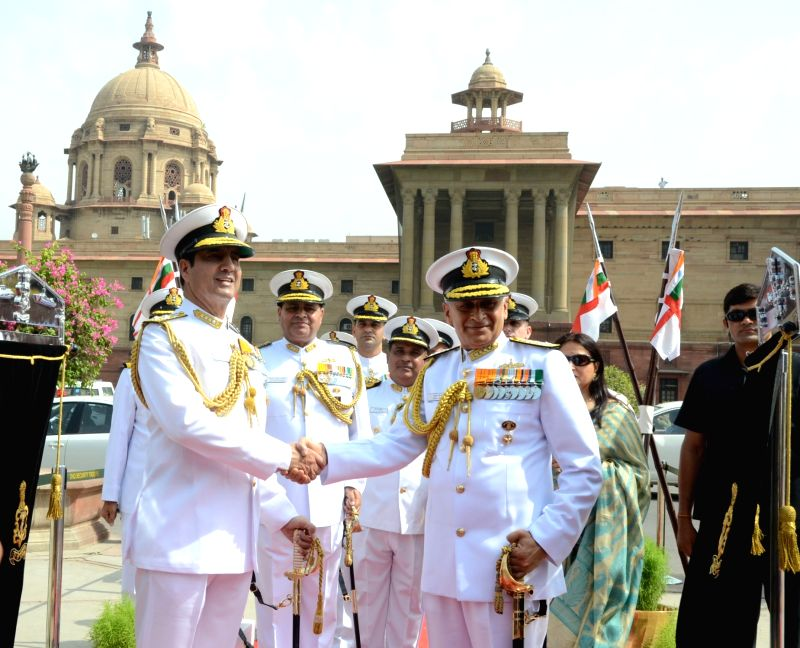 The Chief of Naval Staff, Admiral Sunil Lanba being received by the outgoing Chief of Naval Staff, Admiral RK Dhowan, in New Delhi on May 31, 2016.