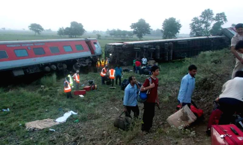 The coaches of Delhi-Dibrugarh Rajdhani Express which were derailed near Goldenganj railway station in Bihar's Saran district on June 25, 2014. At least four people were killed and eight injured ...
