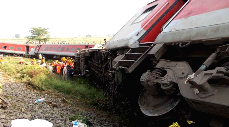 The coaches of Delhi-Dibrugarh Rajdhani Express which were derailed near Golden Ganj railway station in Bihar's Saran district on June 25, 2014. At least four people were killed and eight injured ...