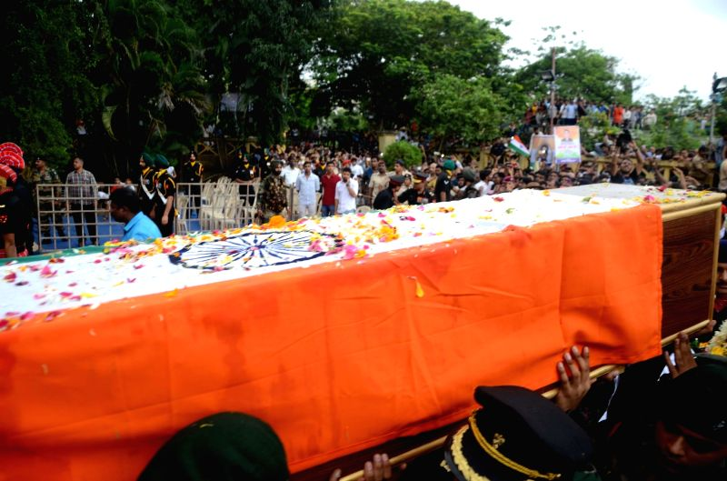 The coffin carrying the body of late Major Kaustubh P. Rane wrapped in tricolor being carried for his last rites, in Maharashtra's Thane on Aug 9, 2018. Rane, 29, was among the four soldiers ...
