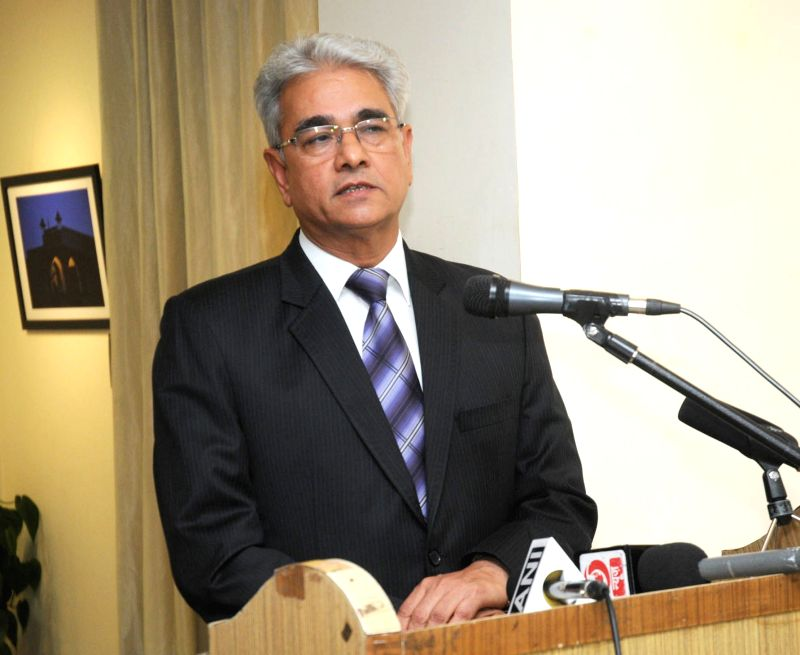 """The Comptroller & Auditor General of India Shashi Kant Sharma addresses at the inauguration of the photo exhibition """"Third Eye"""", in New Delhi on Dec 3, 2015. - Shashi Kant Sharma"""