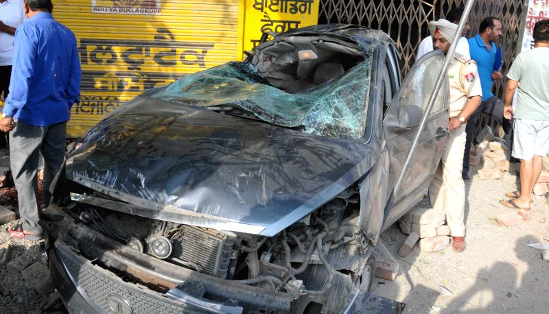 The damaged car which rammed into a tree in Amritsar on May 5, 2014. Five people were killed in the accident.