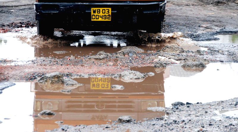 The damaged condition of Eastern Metropolitan Bypass road after heavy rains in Kolkata on July 5, 2014.