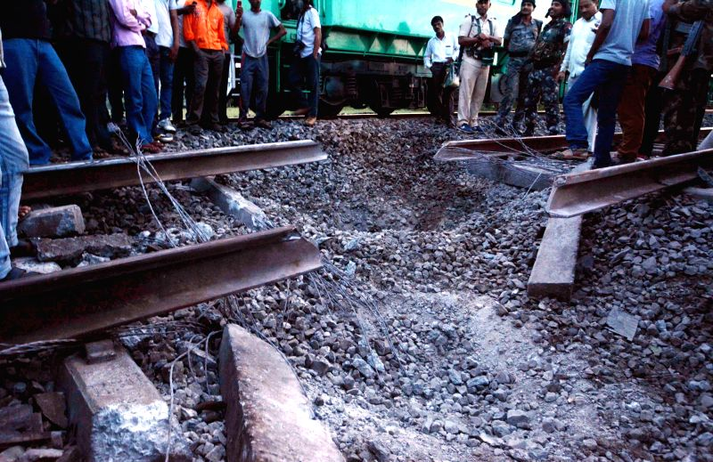 The damaged railway track between Ismailpur and Rafiganj section of Bihar where Maoists triggered an explosion on the intervening night of 22-23 July 2014. A pilot engine running ahead of the ...