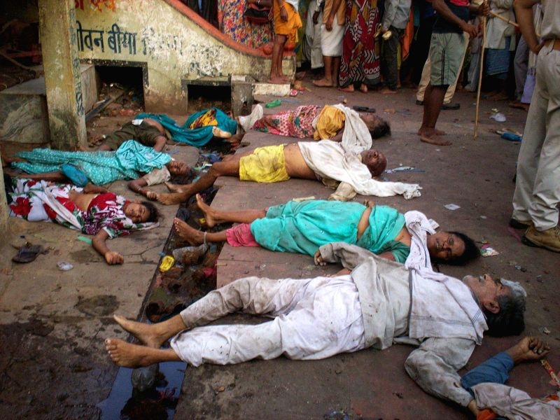 The dead bodies of those who were killed in a stampede that took place when pilgrims were doing a 'parikrama' (circumambulating) of a hill near the Kamta Nath temple in Chitrakoot of Madhya Pradesh's - Kamta Nath