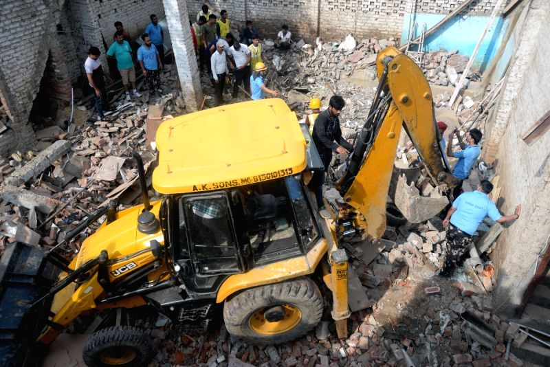 The debris of a two story building that collapsed reportedly killing 10 buffaloes and injuring five persons in Ghazipur of New Delhi on July 17, 2018.