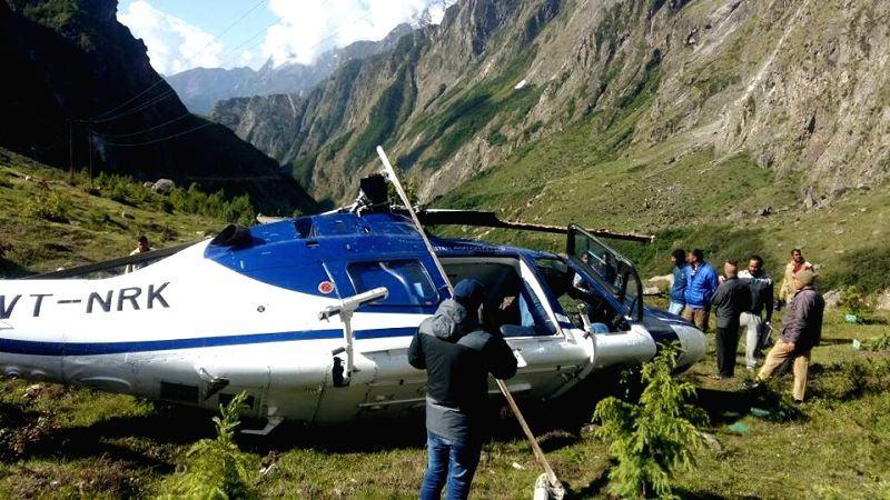 The debris of the eight-seater chopper that crashed near the Bardinath shrine in Uttarakhand killing one person and injuring seven others on June 10, 2017.