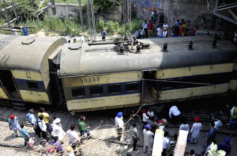 The derailed bogies of Amritsar-Ambala DMU train outside Amritsar railway station on May 5, 2014.