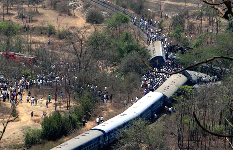 The derailed bogies of Diva-Sawantwadi express near Nagothana in Raigarh of Maharashtra on May 4, 2014. The engine and four coaches of  the train were derailed. Three people are feared dead. 18 ...
