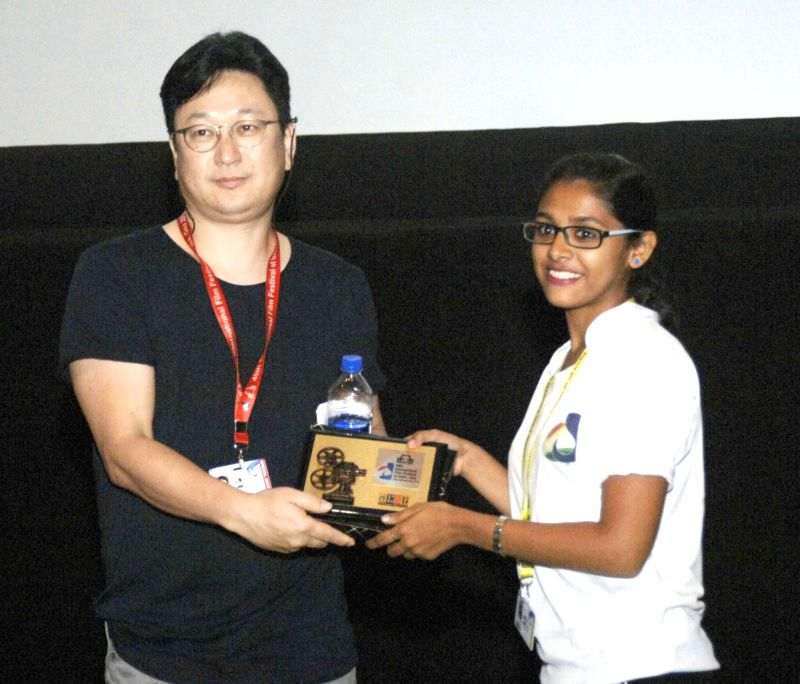 The Director of the film ANGRY PAINTER, Jeon Kyu-hwan being felicitated at the 46th International Film Festival of India (IFFI-2015), in Panaji, Goa on Nov 27, 2015.