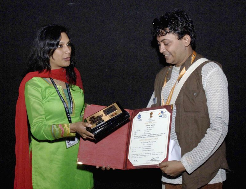 The Director of 'UJANTALI', Somnath Chakraborty being felicitated at the 46th International Film Festival of India (IFFI-2015), in Panaji, Goa on Nov 26, 2015.