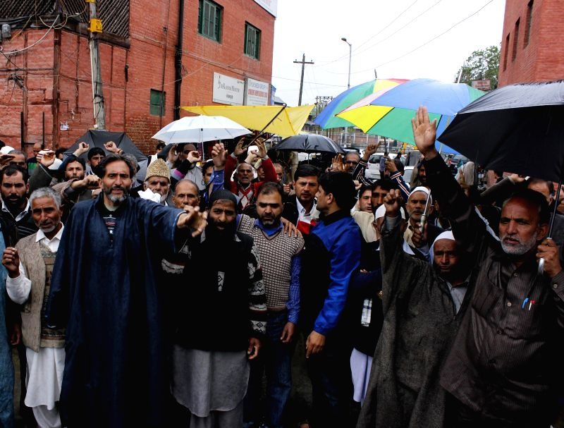 The elected heads of various villages spread across Jammu and Kashmir demonstrate in Srinagar to demand action against the murderers of their colleagues, on May 12, 2014. At least four village heads .