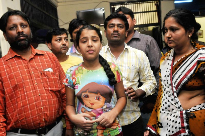The family members of five-year-old Vasu, son of a businessman who was kidnapped on the evening of 24th April, and was found dead near a drain at Wazirabad in North-East Delhi on 25th April; during a