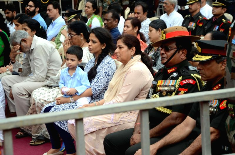 The family members of Major Kaustubh P. Rane at a ceremony where people paid homage to his mortal remains ahead of his last rights, in Maharashtra's Thane on Aug 9, 2018. Thousands of people, ...