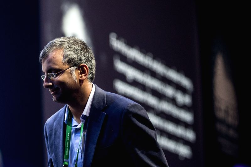 :The Fields Medal winner Akshay Venkatesh of India walks to the stage during the opening ceremony of the 2018 International Congress of Mathematicians in ...