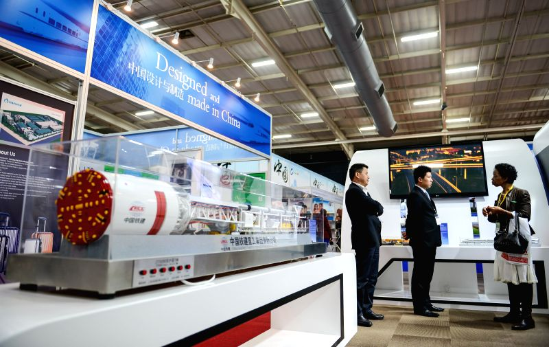 The file photo taken on June 22, 2015 shows a woman visiting the stand of China Railway Construction Corporation during the China Trade Exhibition, in ...
