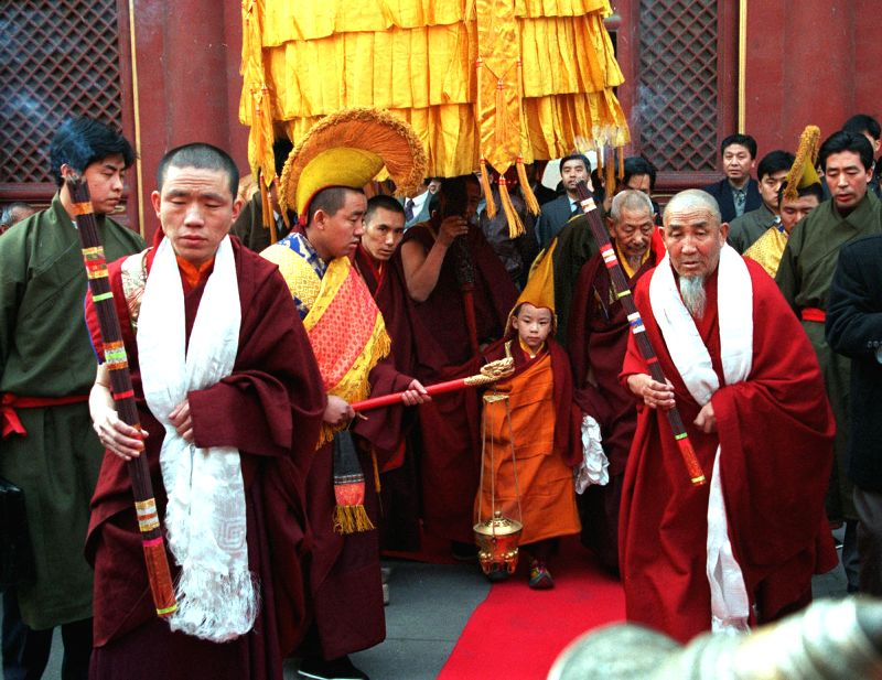The file photo taken on Nov. 22, 1996 shows the 11th Panchen Lama, Bainqen Erdini Qoigyijabu (C), attending a ceremony marking the first anniversary of his ...