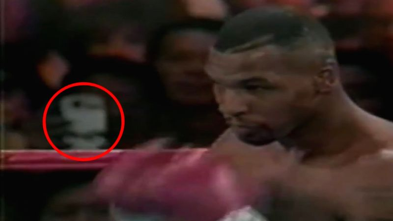 The footage shows a spectator standing in the front row using a phone to film Tyson vs McNeeley match. (Credit: YouTube.com)