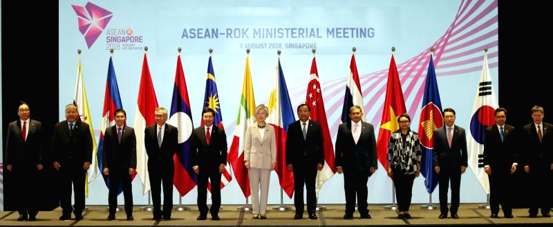 The foreign ministers of South Korea and ASEAN nations pose for a photo at their annual meeting in Singapore on Aug. 3, 2018.
