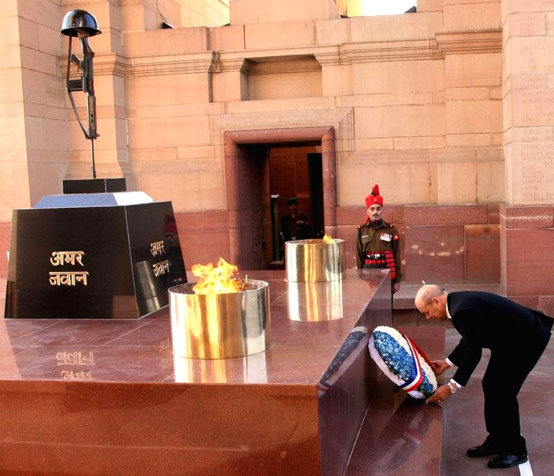 The French Defence Minister Jean-Yves Le Drian lays wreath at Amar Jawan Jyoti, India Gate in New Delhi on Dec 2, 2014. - Jean-Yves L