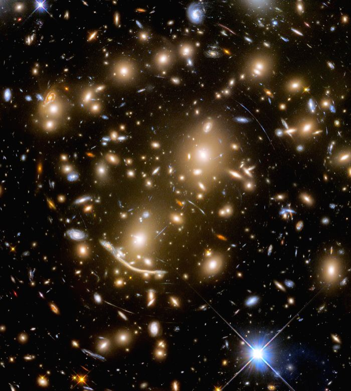 The galaxy cluster called Abell 370 contains an astounding assortment of several hundred galaxies tied together by the mutual pull of gravity. Photo: NASA, ESA/Hubble