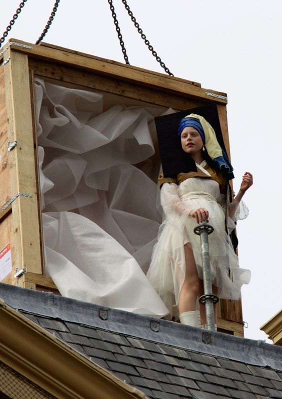 "A girl acting as the ""Girl with the Pearl Earring"", the famous painting of Vermeer, is seen on the roof of the Mauritshuis Museum in the Hague, the ..."