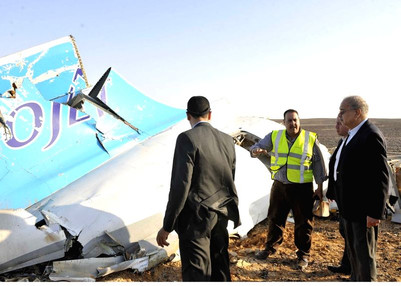The handout photo from Egyptian Prime Minister Office shows Egyptian Prime Minister Sherif Ismail (R) inspecting the crash site of a Russian passenger plane in ... - Office