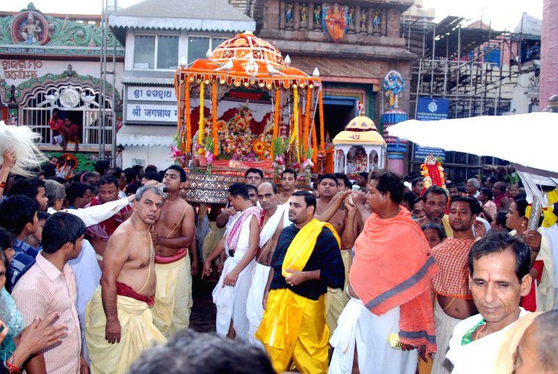 The idol of Lord Jagannath being taken to Narendra pond on Akshaya Tritiya in Puri on May 2, 2014.
