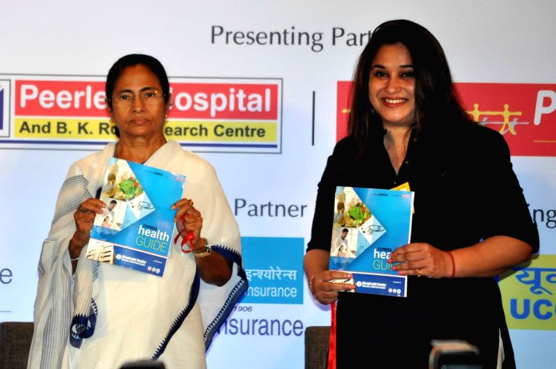 "The Indian Express General Manager Sales Sanghamitra Kumar along with West Bengal Chief Minister Mamata Banerjee during a Round table conference on ""Healthy Living In Corporate ... - Mamata Banerjee"